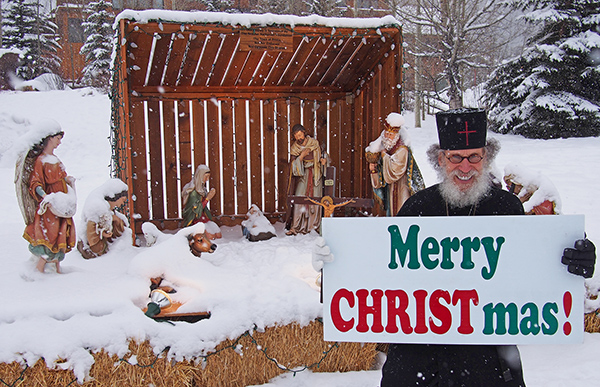 Brother Nathanael with Nativity Scene